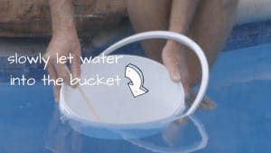 add calcium to a pool, dissolve calcium before pouring into pool