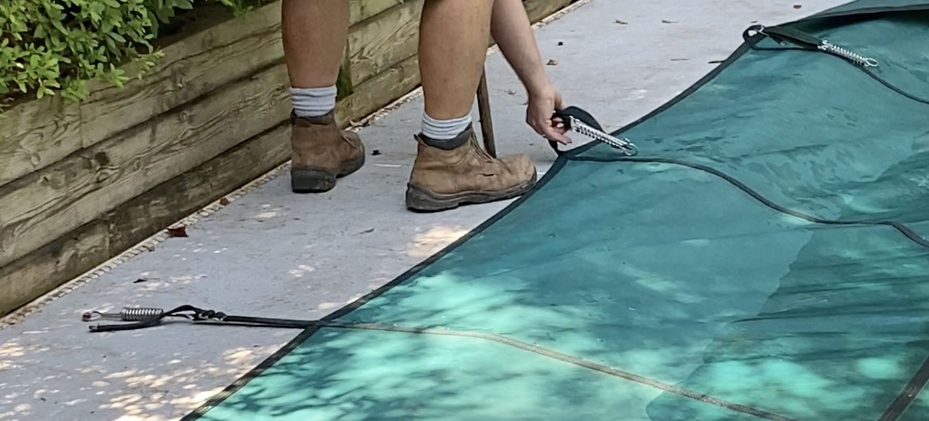installing a pool safety cover, solid pool cover